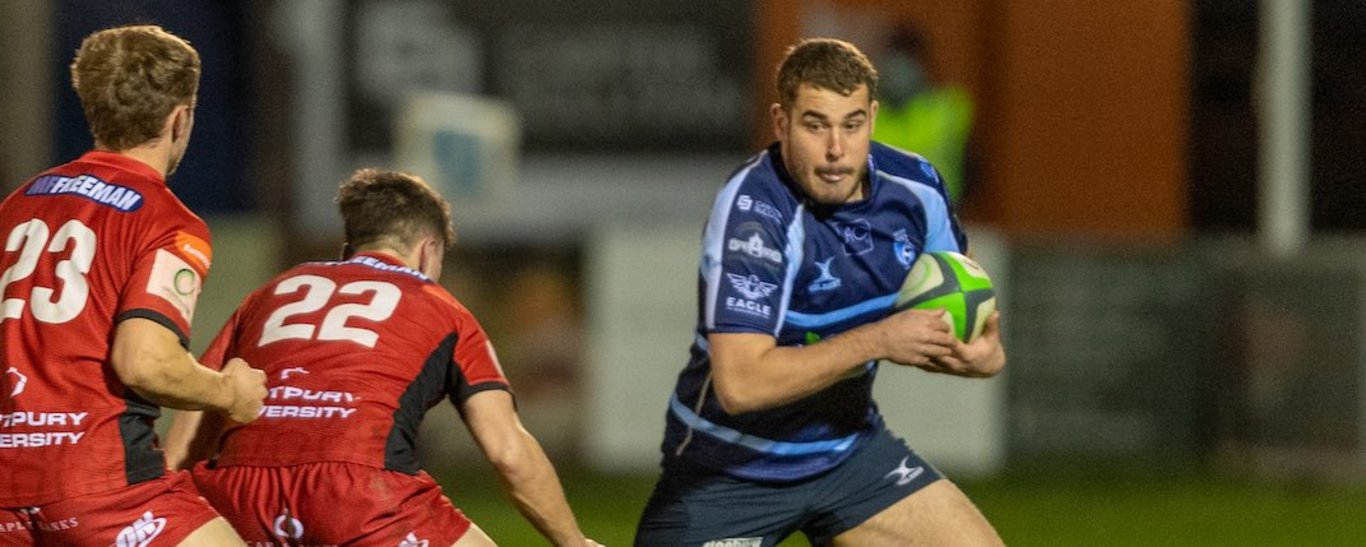 Saints' Jack Hughes carries for Bedford Blues