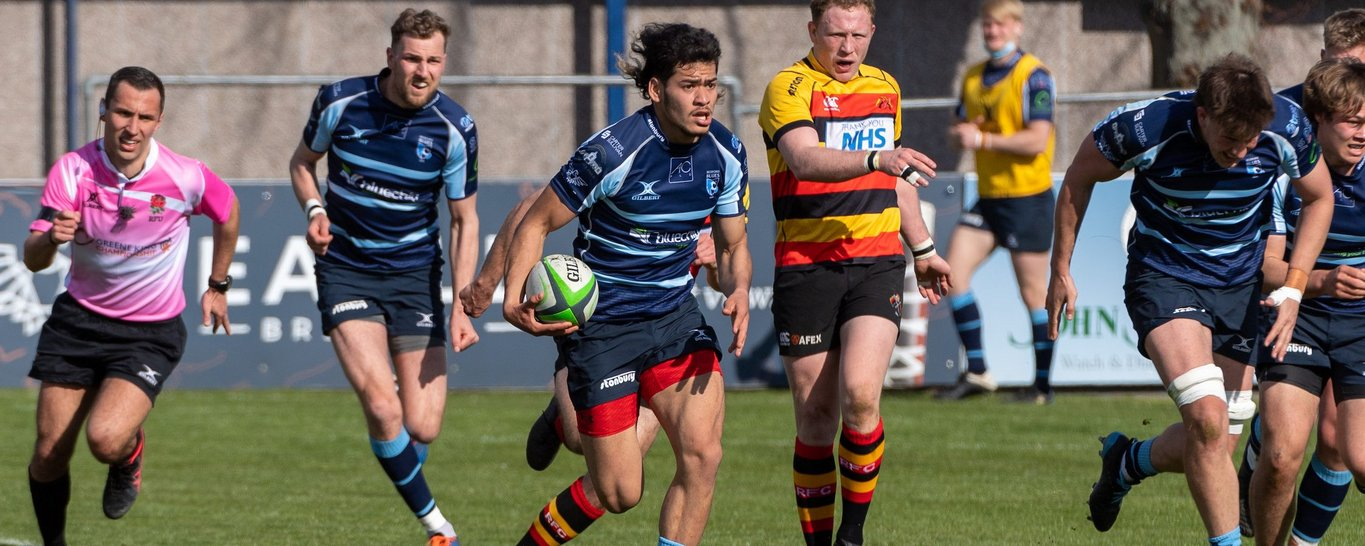 Saints' Connor Tupai on the charge for Bedford Blues