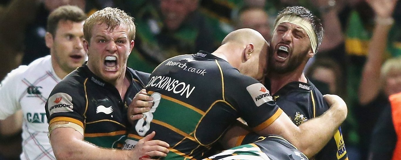 Tom Wood, Mikey Haywood and Sam Dickinson celebrate a Northampton Saints try