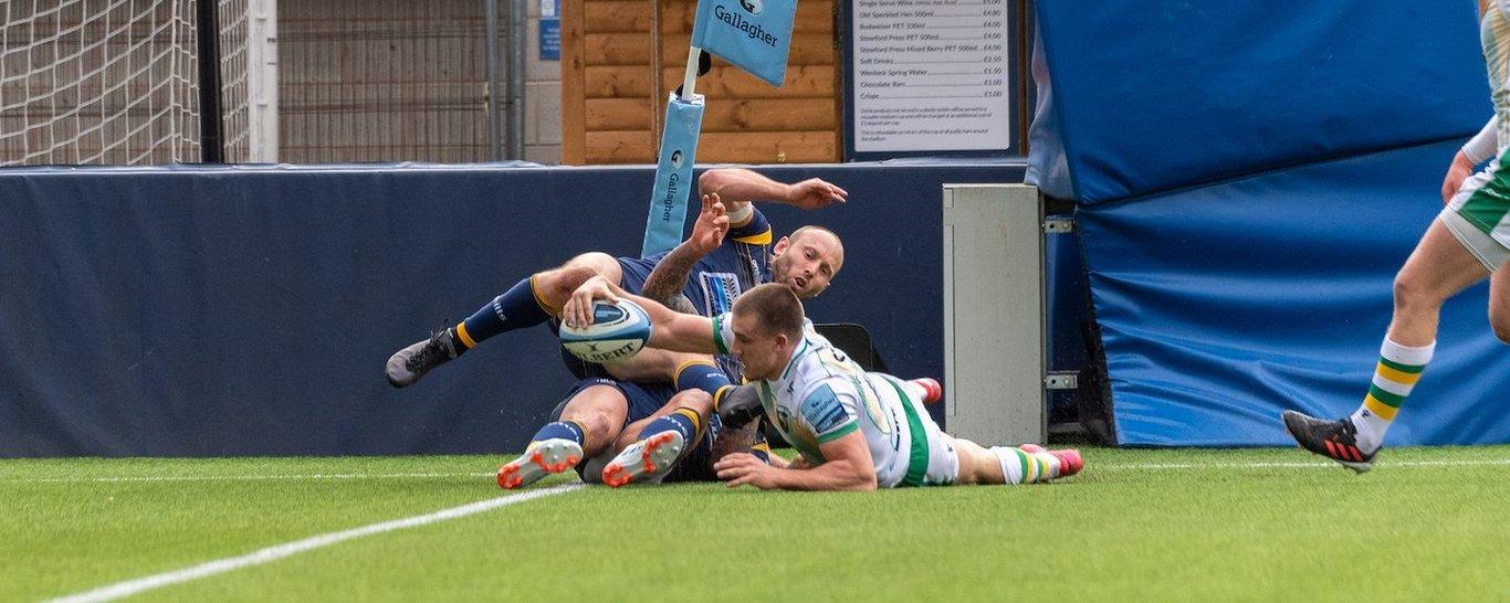 Northampton Saints' Ollie Sleightholme scores a try