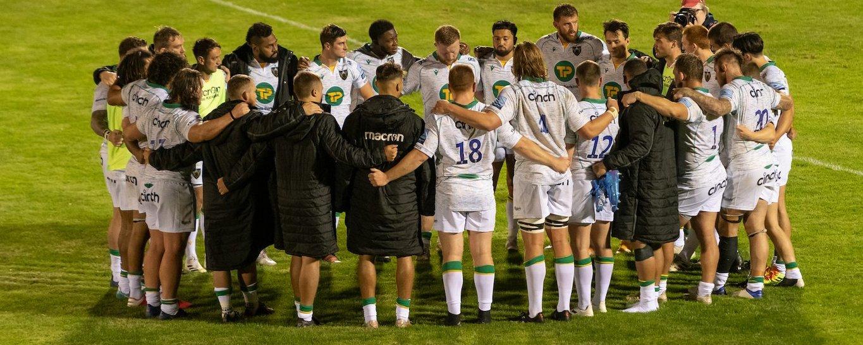 Northampton Saints' players huddle together
