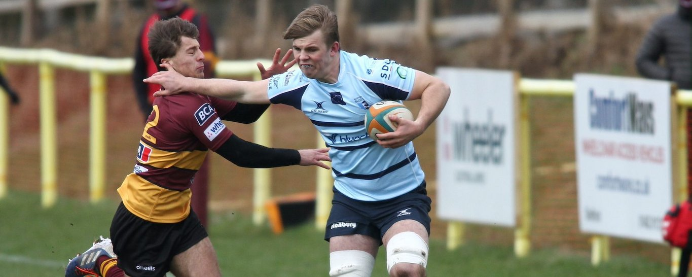 Northampton Saints' Ollie Newman carries for Bedford Blues