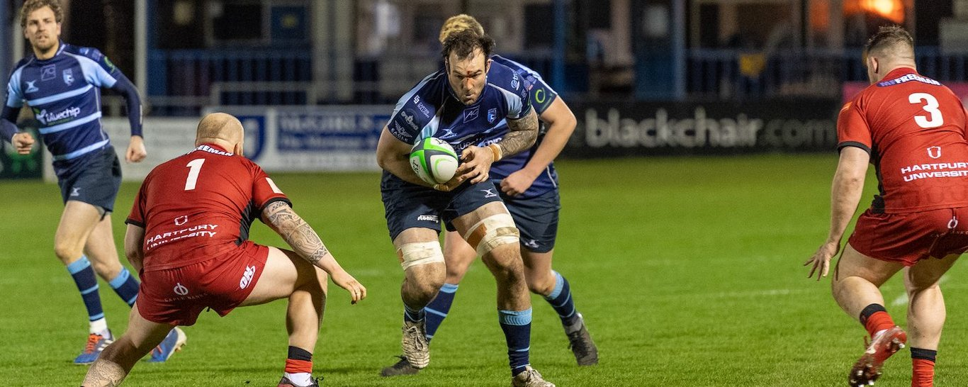 Northampton Saints' Lewis Bean on the charge for Bedford Blues