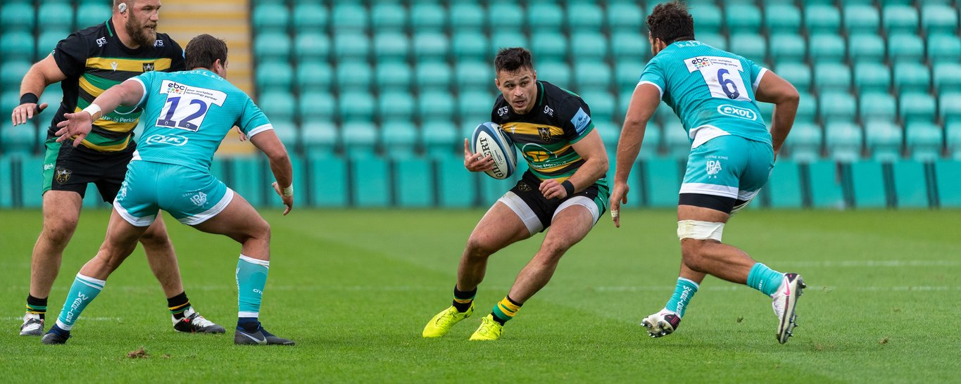 Tom Collins carries for Northampton Saints