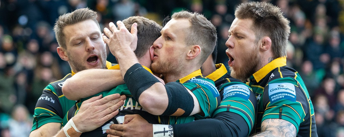 Northampton Saints celebrate a try.