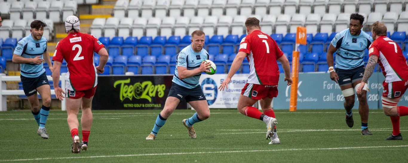 James Fish of Northampton Saints on the charge for Bedford Blues
