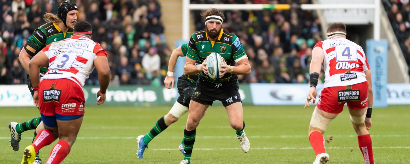 Tom Wood carries against Gloucester
