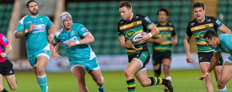 Dan Biggar carries for Northampton Saints