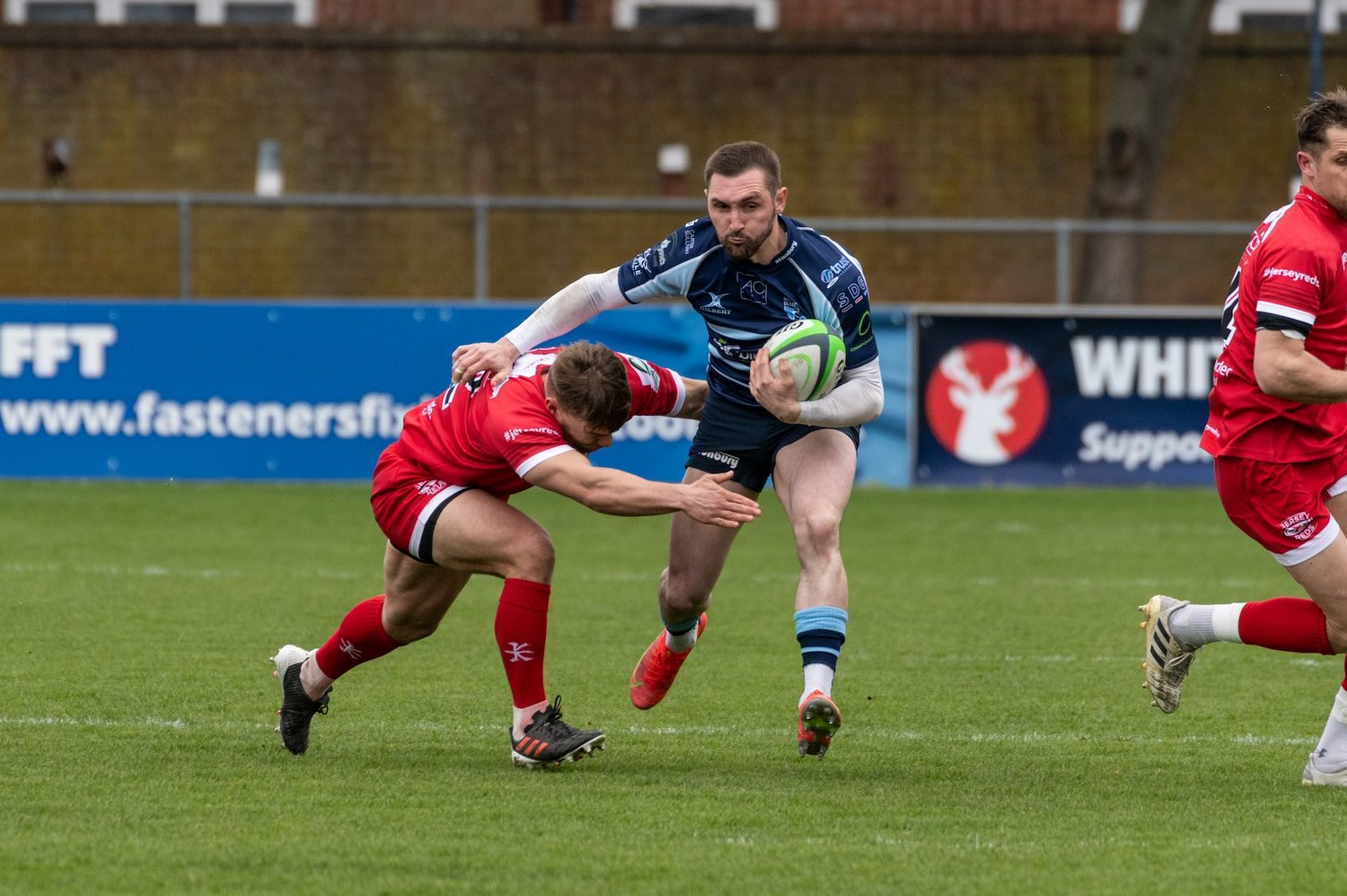 Bedford Blues' captain Rich Lane on the charge